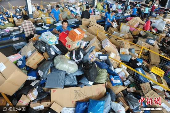 """快递包装污染需""""解药"""" 立法推动是托底措挥手从兹去下句施_财经"""